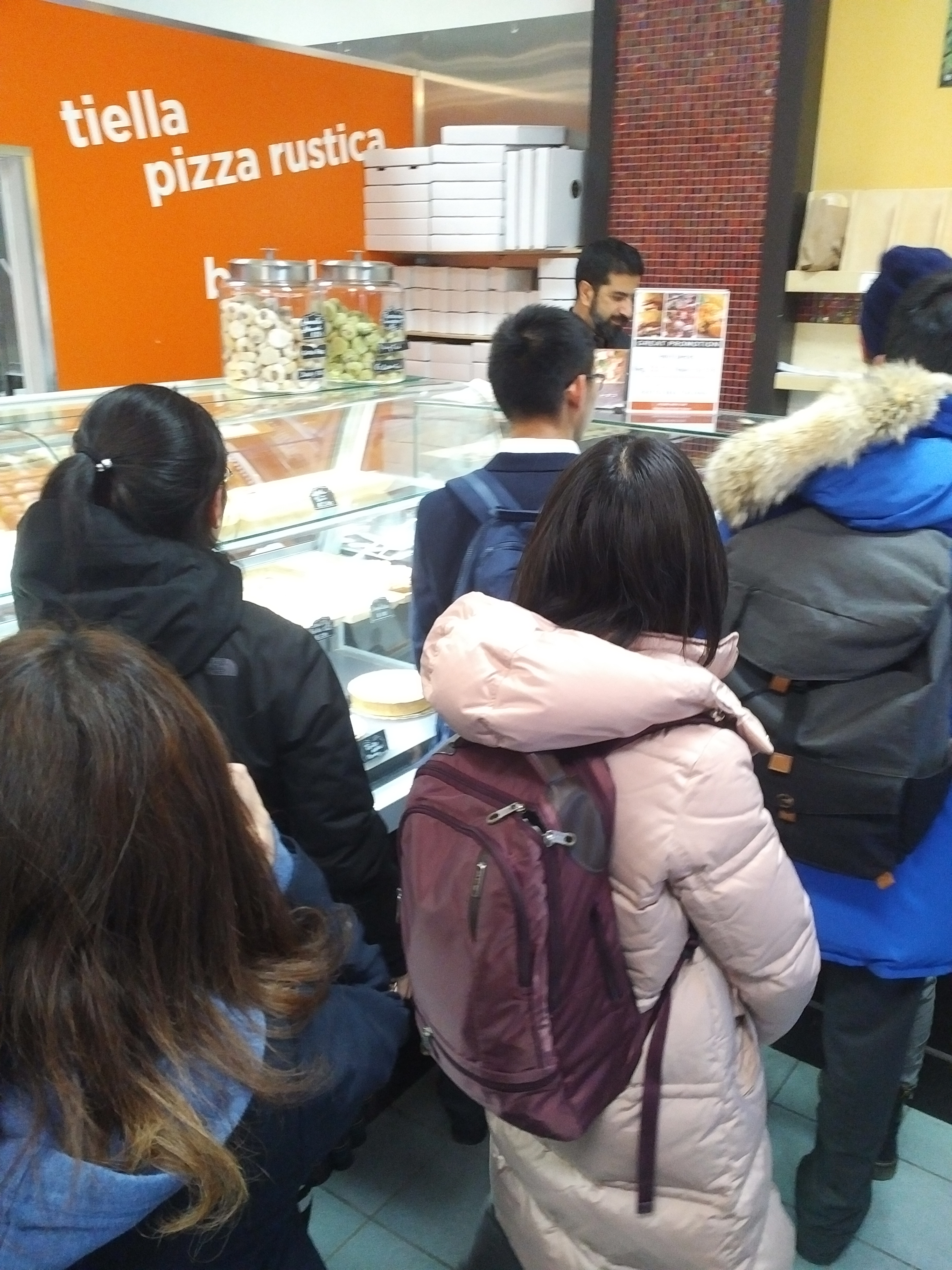 Volunteers being treated to pizza and pastries after their hard work