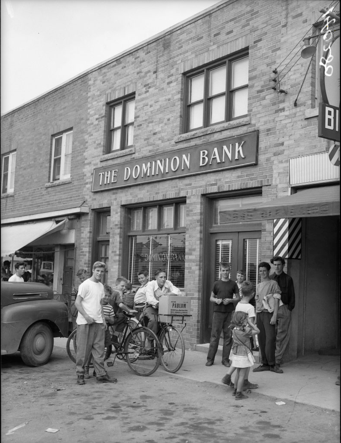 Outside of the Dominion bank at Dufferin Street and Glencairn Avenue after a bank robbery on July 4, 1950