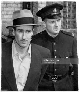 Edwin Alonzo Boyd, left, in a 1952 photo, favoured guns when he robbed Toronto-area banks